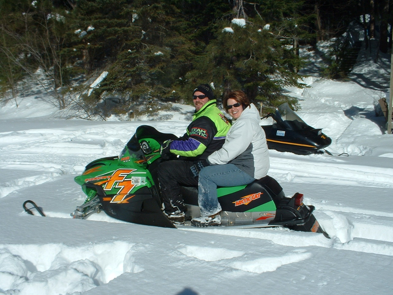 guests on their snowmobile