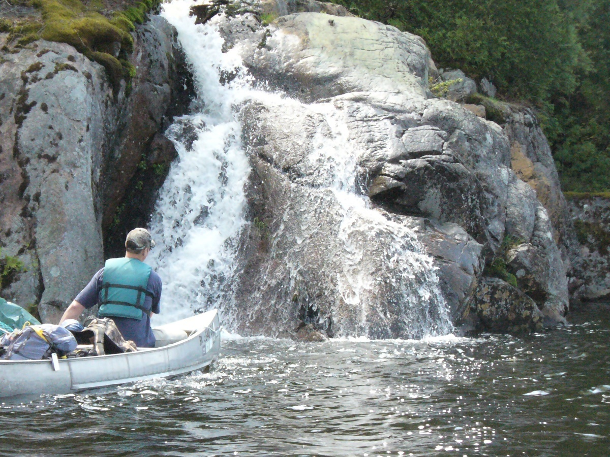 paddling past waterfall